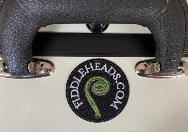 White mandolin case with fiddleheads embroidered patch