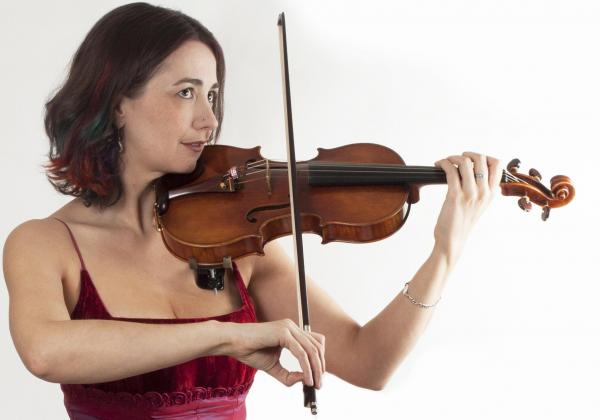 Rhiannon in red dress playing violin