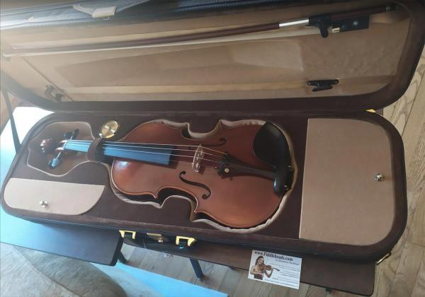 Left-handed 102 violiln in a brown case