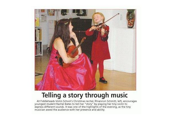 Rhiannon, kneeling in a formal red dress, listens as little Rachel tells a story  while playing violin