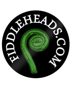 """Black circle with pretty green fern in the centre, surrounded by white circular writing saying """"FIDDLEHEADS.COM"""""""