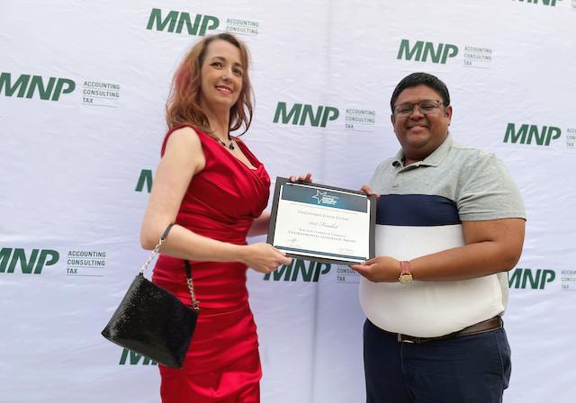 Rhiannon accepts finalist certificate for Environmental Leadership Award from Abhinav Ashok