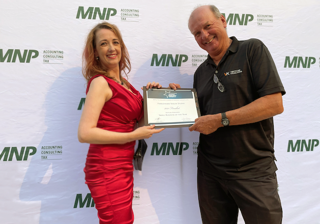 Rhiannon accepts finalist certificate for Small Business of the Year Award from Brant Hasanen