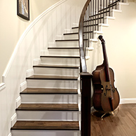 Stairs with a bass beside them