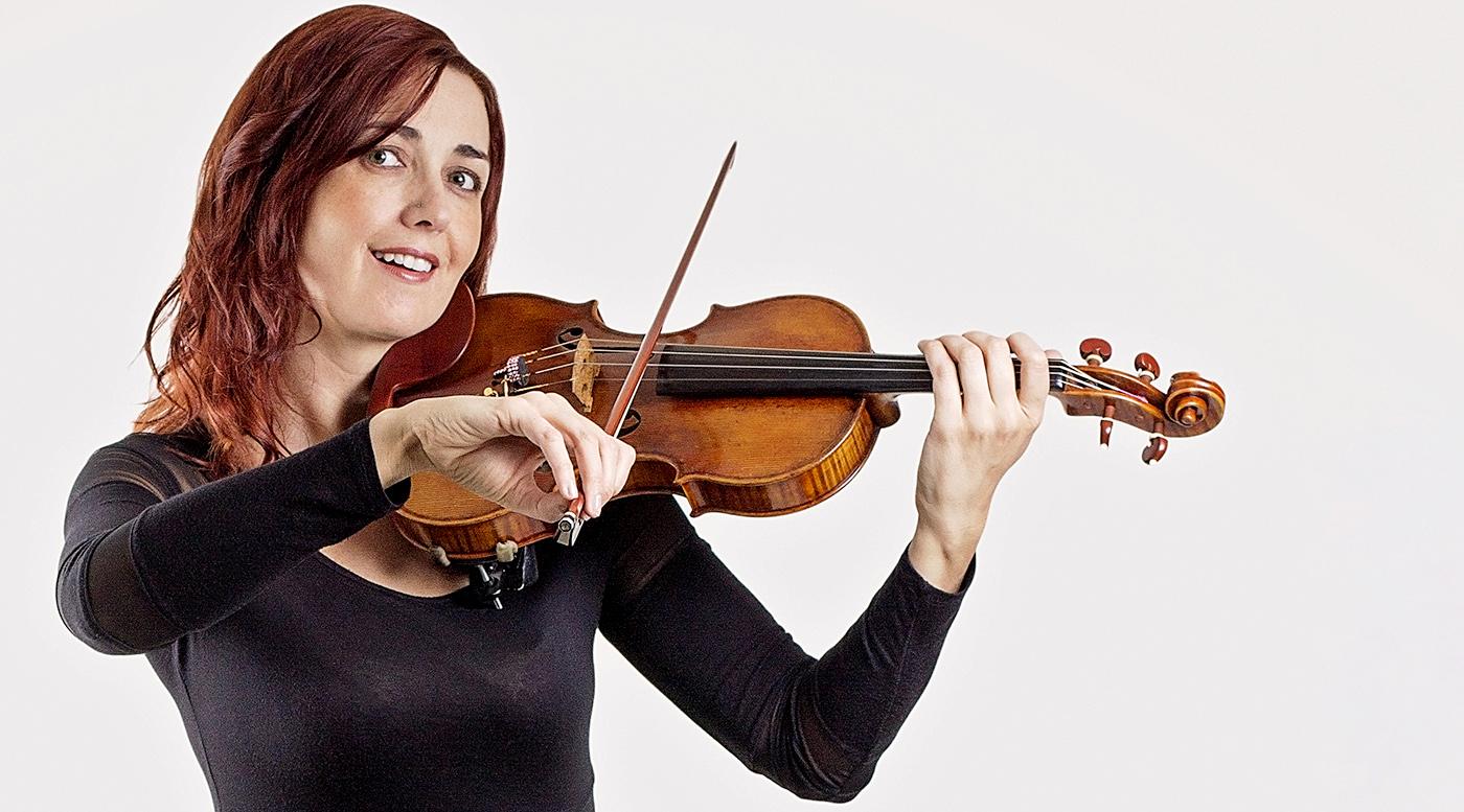 Red-headed Rhiannon in black dress playing violin
