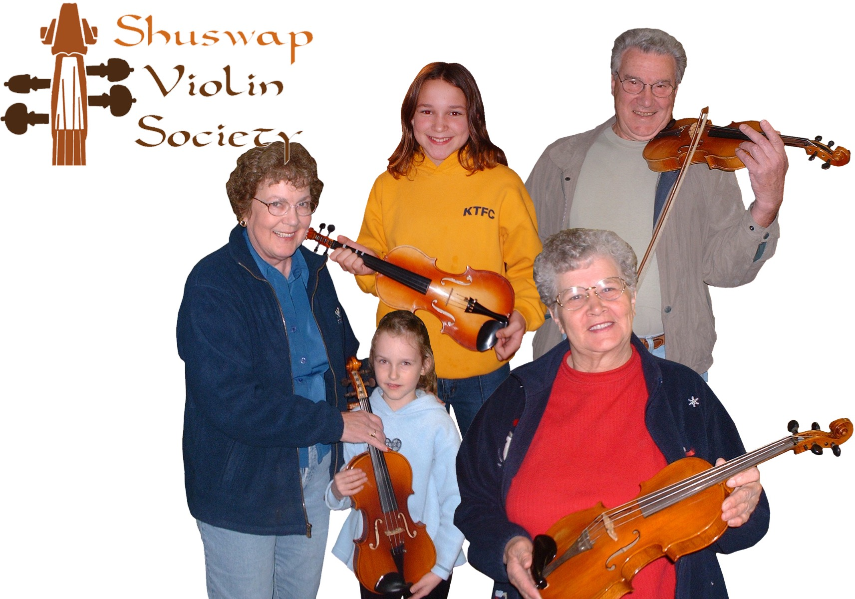 various seniors and children holding violins they have donated