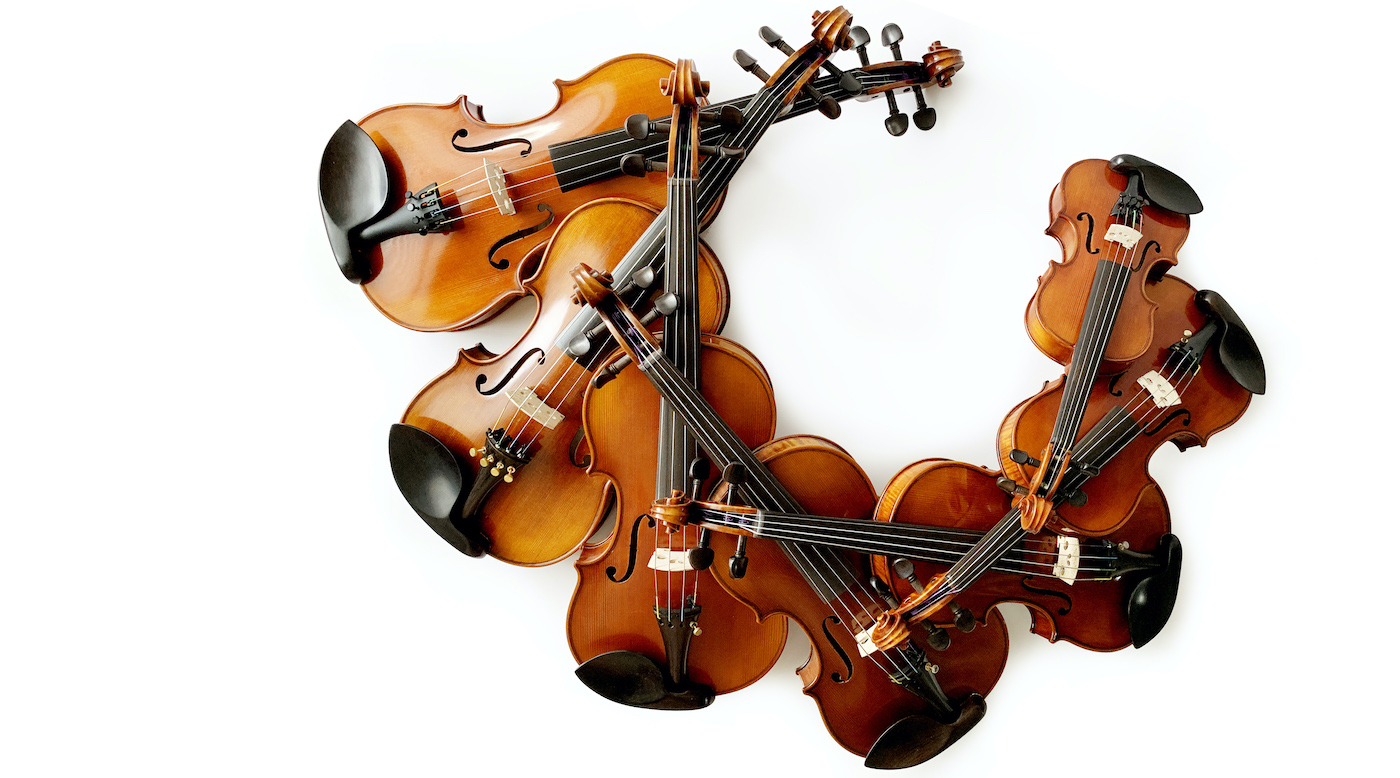 lots of violins stacked on top of each other