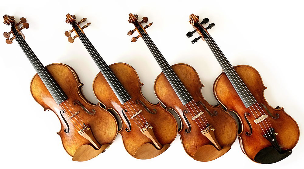 four Zhu violins in a row leaning diagonally
