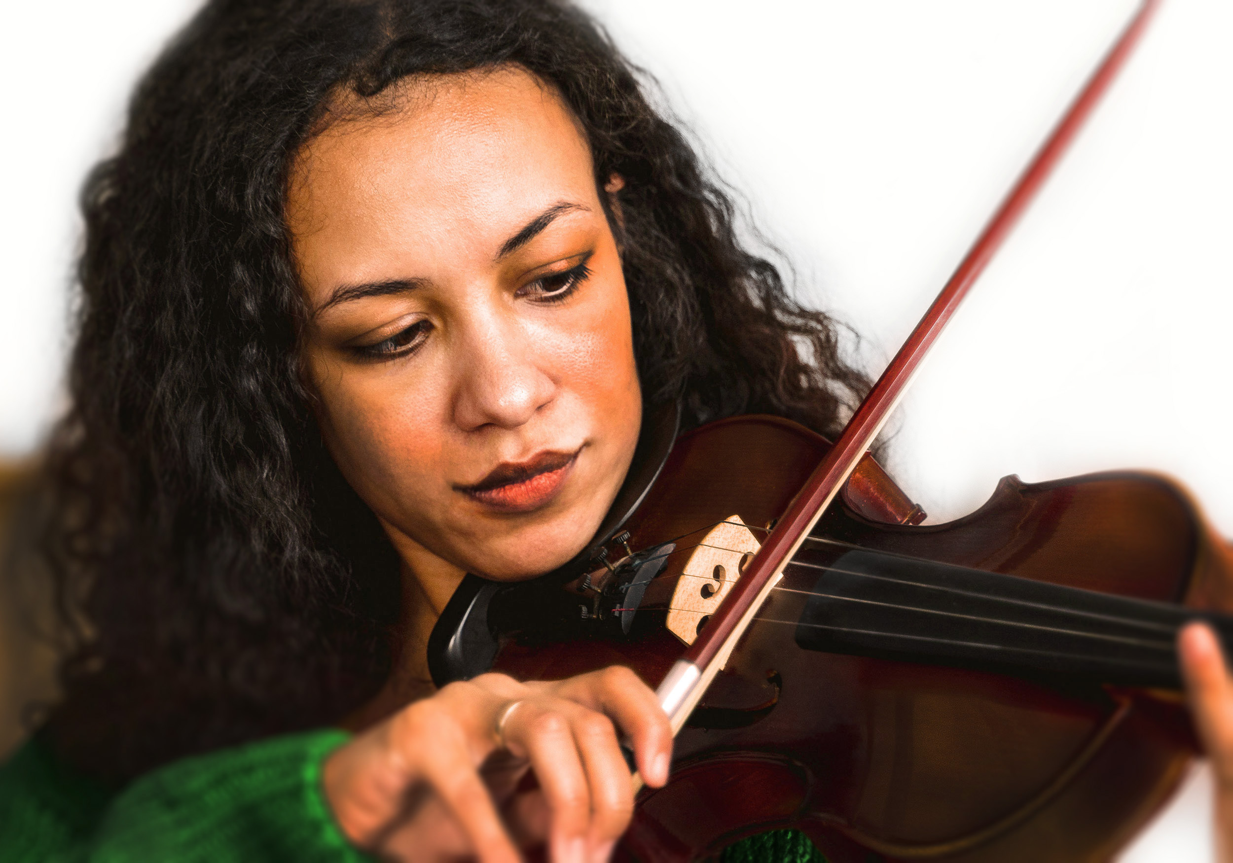 beautiful black woman with beautiful curly long hair and a green sweater smirking while playing a violin