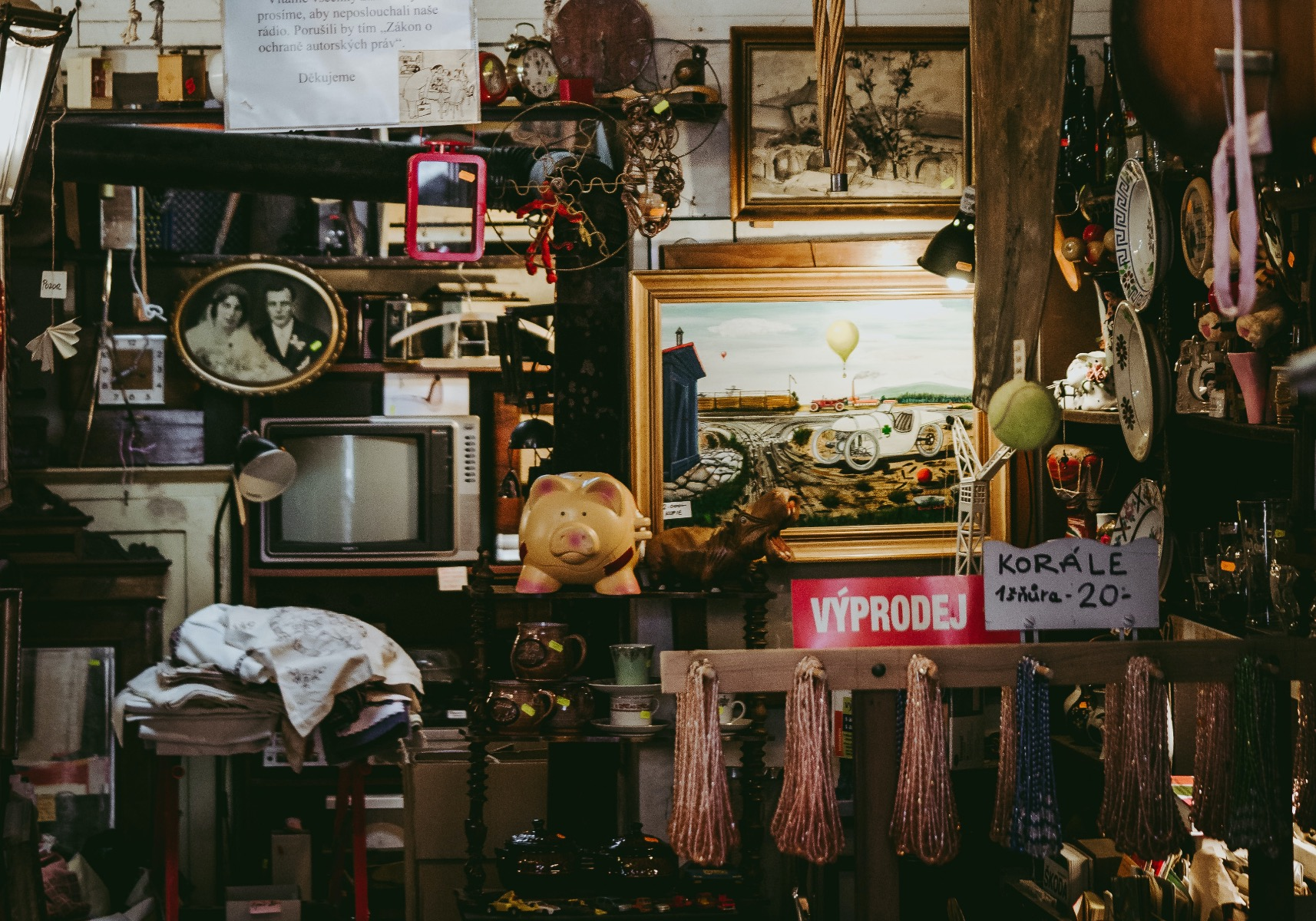 Cluttered and messy pawn shop with cheap junk